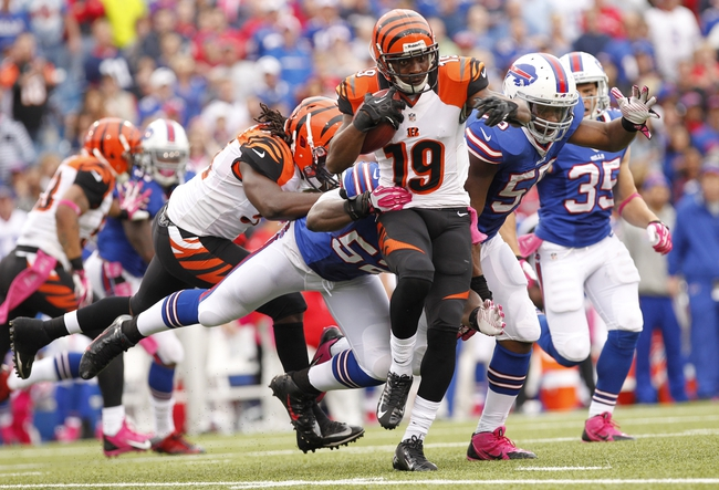 Oct 13, 2013; Orchard Park, NY, USA; Buffalo Bills outside linebacker Arthur Moats (52) tackles Cincinnati Bengals wide receiver Brandon Tate (19) during the second half at Ralph Wilson Stadium. Bengals beat the Bills 27-24 in overtime. Mandatory Credit: Kevin Hoffman-USA TODAY Sports