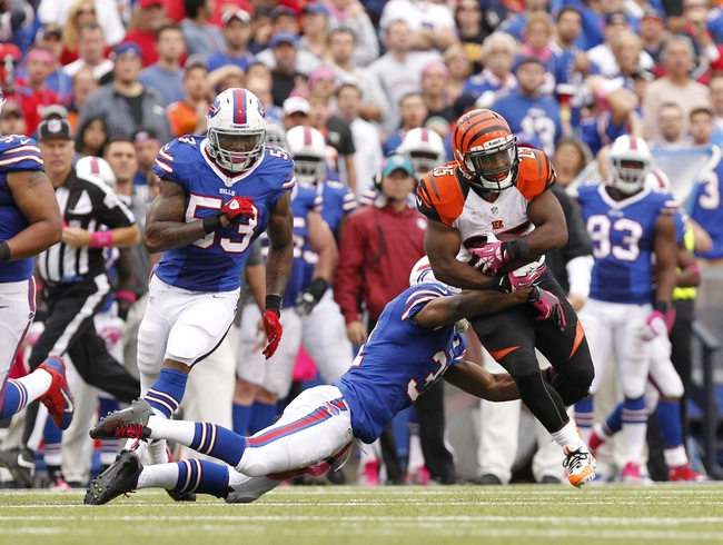 Oct 13, 2013; Orchard Park, NY, USA; Buffalo Bills free safety Jairus Byrd (31) tackles Cincinnati Bengals running back Giovani Bernard (25) during the second half at Ralph Wilson Stadium. Bengals beat the Bills 27-24 in overtime. Mandatory Credit: Kevin Hoffman-USA TODAY Sports