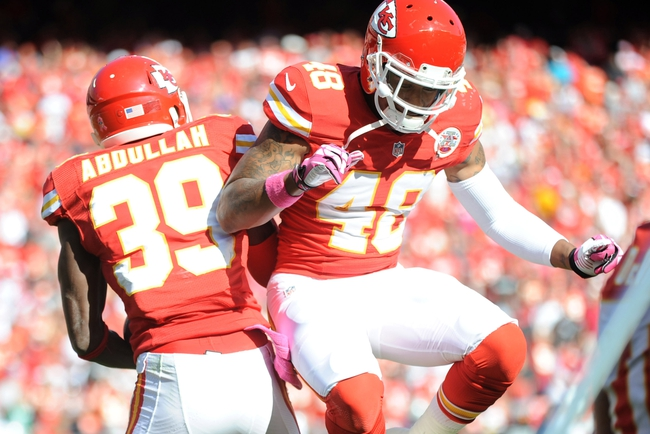 Oct 13, 2013; Kansas City, MO, USA; Kansas City Chiefs defensive back Husain Abdullah (39) is congratulated by safety Bradley McDougald (48) after Abdullah scores during the second half of the game against the Oakland Raiders at Arrowhead Stadium. The Chiefs won 24-7. Mandatory Credit: Denny Medley-USA TODAY Sports