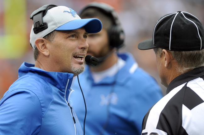Oct 13, 2013; Cleveland, OH, USA; Detroit Lions head coach Jim Schwartz talks with the officials during the third quarter against the Cleveland Browns at FirstEnergy Stadium. The Lions beat the Browns 31-17. Mandatory Credit: Ken Blaze-USA TODAY Sports