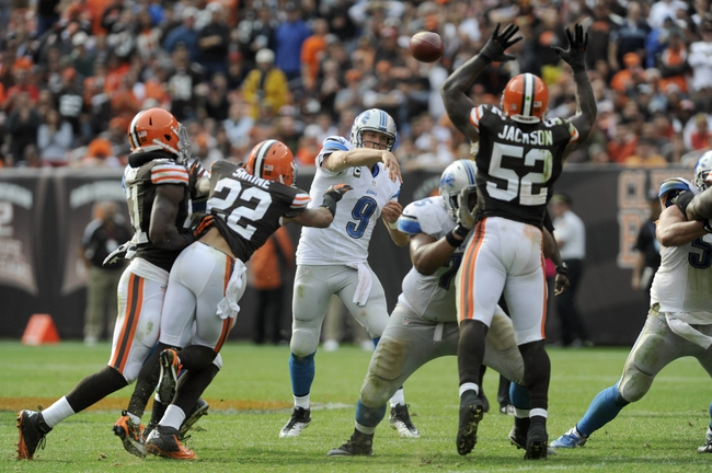 Oct 13, 2013; Cleveland, OH, USA; Detroit Lions quarterback Matthew Stafford (9) throws a pass against the Cleveland Browns during the fourth quarter at FirstEnergy Stadium. Mandatory Credit: Ken Blaze-USA TODAY Sports