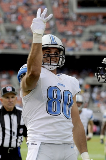 Oct 13, 2013; Cleveland, OH, USA; Detroit Lions tight end Joseph Fauria (80) signals after catching his third touchdown pass during the fourth quarter against the Cleveland Browns at FirstEnergy Stadium. The Lions beat the Browns 31-17. Mandatory Credit: Ken Blaze-USA TODAY Sports