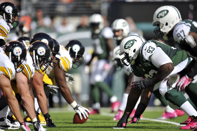 Oct 13, 2013; East Rutherford, NJ, USA; New York Jets and Pittsburgh Steelers players line up for a play during the second half at MetLife Stadium. The Steelers won the game 19-6. Mandatory Credit: Joe Camporeale-USA TODAY Sports