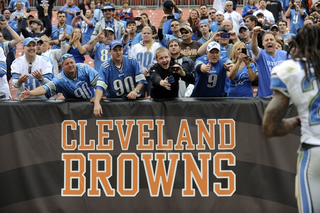 Oct 13, 2013; Cleveland, OH, USA; Detroit Lions fans cheer as Detroit Lions free safety Louis Delmas (26) leaves the field after the game against the Cleveland Browns at FirstEnergy Stadium. The Lions beat the Cleveland Browns 31-17. Mandatory Credit: Ken Blaze-USA TODAY Sports