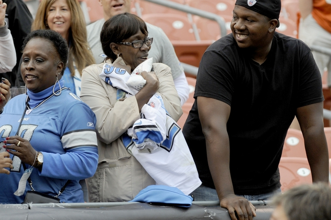 Oct 13, 2013; Cleveland, OH, USA; Blanche Hereford of Cleveland holds the jersey of Detroit Lions free safety Louis Delmas (not pictured) after Delmas gave her his jersey after the game against the Cleveland Browns at FirstEnergy Stadium. The Lions beat the Browns 31-17. Mandatory Credit: Ken Blaze-USA TODAY Sports