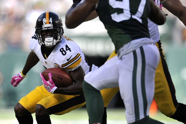 Oct 13, 2013; East Rutherford, NJ, USA; Pittsburgh Steelers wide receiver Antonio Brown (84) runs after a catch against the New York Jets during the second half at MetLife Stadium. The Steelers won the game 19-6. Mandatory Credit: Joe Camporeale-USA TODAY Sports
