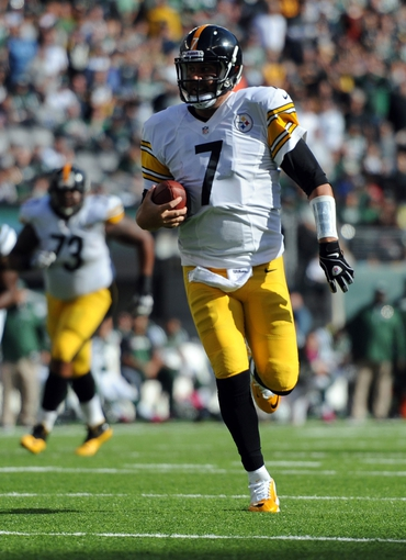 Oct 13, 2013; East Rutherford, NJ, USA; Pittsburgh Steelers quarterback Ben Roethlisberger (7) scrambles for a first down against the New York Jets during the second half at MetLife Stadium. The Steelers won the game 19-6. Mandatory Credit: Joe Camporeale-USA TODAY Sports