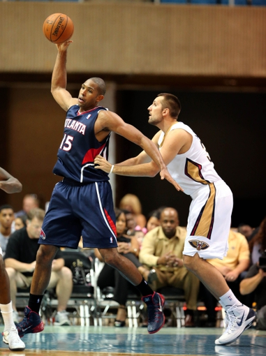 Oct 13, 2013; Biloxi, MS, USA; Atlanta Hawks power forward Al Horford (15) is defended by New Orleans Pelicans forward Ryan Anderson (33) during the second half of their game at the Mississippi Coast Coliseum. The Pelicans won 105-73. Mandatory Credit: Chuck Cook-USA TODAY Sports