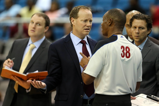 Oct 13, 2013; Biloxi, MS, USA;  Atlanta Hawks head coach Mike Budenholzer talks to referee Michael Smith during the second half of their game against the New Orleans Pelicans at the Mississippi Coast Coliseum. The Pelicans won 105-73. Mandatory Credit: Chuck Cook-USA TODAY Sports