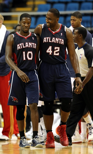 Oct 13, 2013; Biloxi, MS, USA; Atlanta Hawks point guard Royal Ivey (10) and  power forward Elton Brand (42) walk off the court at the end of their game against the New Orleans Pelicans at the Mississippi Coast Coliseum. The Pelicans won 105-73. Mandatory Credit: Chuck Cook-USA TODAY Sports