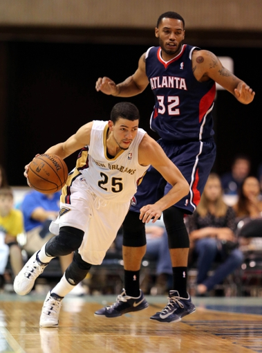 Oct 13, 2013; Biloxi, MS, USA; New Orleans Pelicans shooting guard Austin Rivers (25) heads up the court after stealing the ball from Atlanta Hawks power forward Mike Scott (32) during the second half of their game at the Mississippi Coast Coliseum. The Pelicans won 105-73. Mandatory Credit: Chuck Cook-USA TODAY Sports