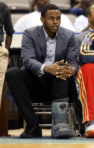 Oct 13, 2013; Biloxi, MS, USA; New Orleans Pelicans small forward Darius Miller (2) watches his team play the Atlanta Hawks from the bench with an injured left foot during the first half of their game at the Mississippi Coast Coliseum. Mandatory Credit: Chuck Cook-USA TODAY Sports