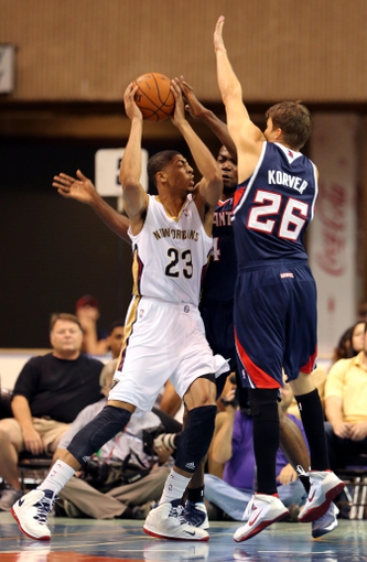 Oct 13, 2013; Biloxi, MS, USA; New Orleans Pelicans power forward Anthony Davis (23) is defended by Atlanta Hawks shooting guard Kyle Korver (26) and power forward Paul Millsap (4) during the first half of their game at the Mississippi Coast Coliseum. Mandatory Credit: Chuck Cook-USA TODAY Sports