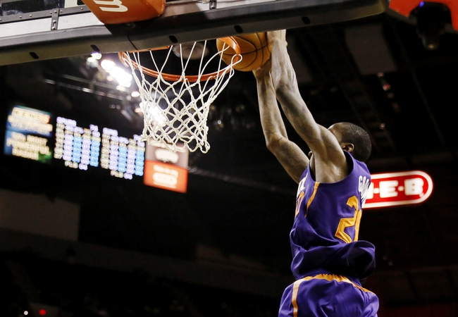 Oct 13, 2013; San Antonio, TX, USA; Phoenix Suns  guard Archie Goodwin (20) dunks against the San Antonio Spurs during the second half at AT&T Center. The Suns won 106-99. Mandatory Credit: Soobum Im-USA TODAY Sports