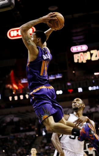 Oct 13, 2013; San Antonio, TX, USA; Phoenix Suns  guard Gerald Green (14) goes up for a dunk against the San Antonio Spurs during the second half at AT&T Center. The Suns won 106-99. Mandatory Credit: Soobum Im-USA TODAY Sports