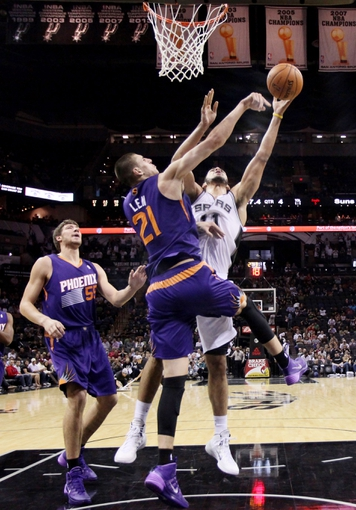 Oct 13, 2013; San Antonio, TX, USA; San Antonio Spurs forward Jeff Ayres (behind) has his shot blocked by Phoenix Suns  center Alex Len (front) during the second half at AT&T Center. The Suns won 106-99. Mandatory Credit: Soobum Im-USA TODAY Sports