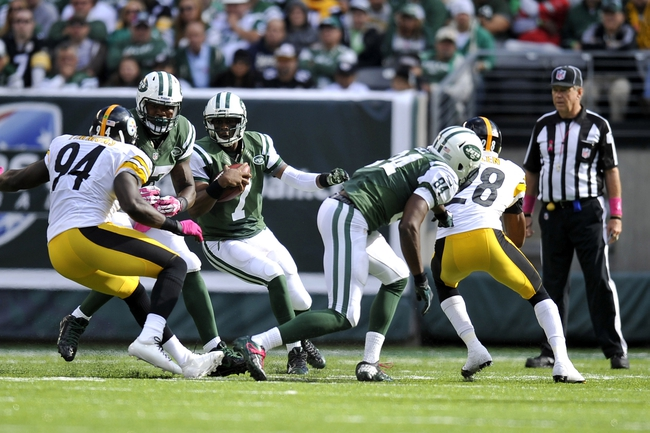 Oct 13, 2013; East Rutherford, NJ, USA; New York Jets quarterback Geno Smith (7) scrambles against the Pittsburgh Steelers during the second half at MetLife Stadium. The Steelers won the game 19-6. Mandatory Credit: Joe Camporeale-USA TODAY Sports