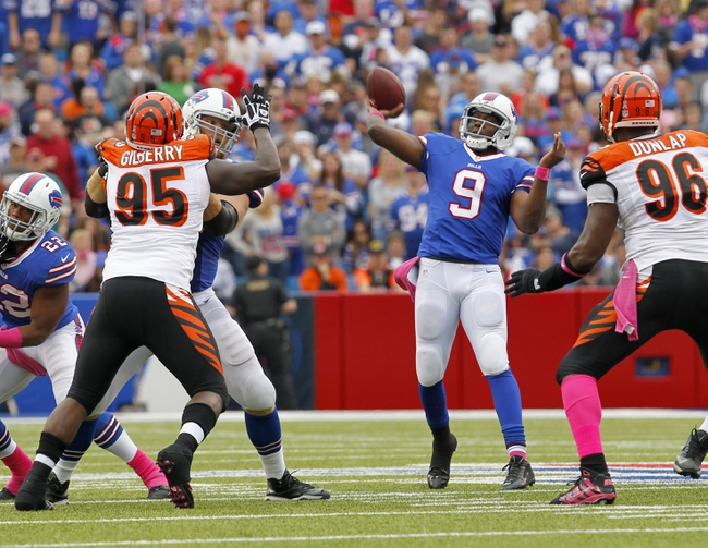 Oct 13, 2013; Orchard Park, NY, USA; Buffalo Bills quarterback Thad Lewis (9) throws a pass during the second half against the Cincinnati Bengals at Ralph Wilson Stadium. Bengals beat the Bills 27 to 24 in overtime.  Mandatory Credit: Timothy T. Ludwig-USA TODAY Sports