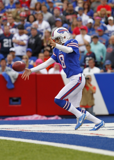 Oct 13, 2013; Orchard Park, NY, USA; Buffalo Bills punter Brian Moorman (8) punts the ball during the second half against the Cincinnati Bengals at Ralph Wilson Stadium. Bengals beat the Bills 27 to 24 in overtime.  Mandatory Credit: Timothy T. Ludwig-USA TODAY Sports