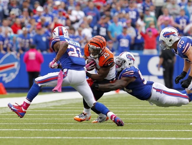 Oct 13, 2013; Orchard Park, NY, USA; Buffalo Bills outside linebacker Nigel Bradham (53) dives to make a tackle on Cincinnati Bengals running back Giovani Bernard (25) during the second half at Ralph Wilson Stadium. Bengals beat the Bills 27 to 24 in overtime.  Mandatory Credit: Timothy T. Ludwig-USA TODAY Sports