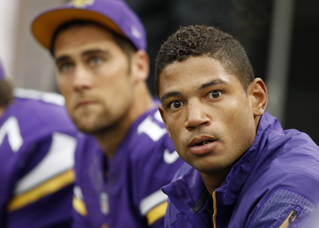 Oct 13, 2013; Minneapolis, MN, USA; Minnesota Vikings quarterback Josh Freeman (12) sits on the sidelines in the game against the Carolina Panthers at Mall of America Field at H.H.H. Metrodome. Panthers win 35-10. Mandatory Credit: Bruce Kluckhohn-USA TODAY Sports