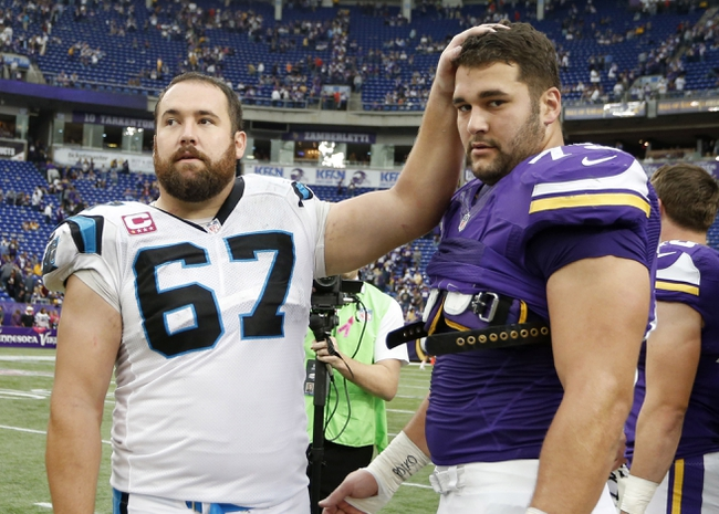 Oct 13, 2013; Minneapolis, MN, USA; Carolina Panthers center Ryan Kalil (67) meets with his brother Minnesota Vikings tackle Matt Kalil (75) after the game at Mall of America Field at H.H.H. Metrodome. Panthers win 35-10. Mandatory Credit: Bruce Kluckhohn-USA TODAY Sports
