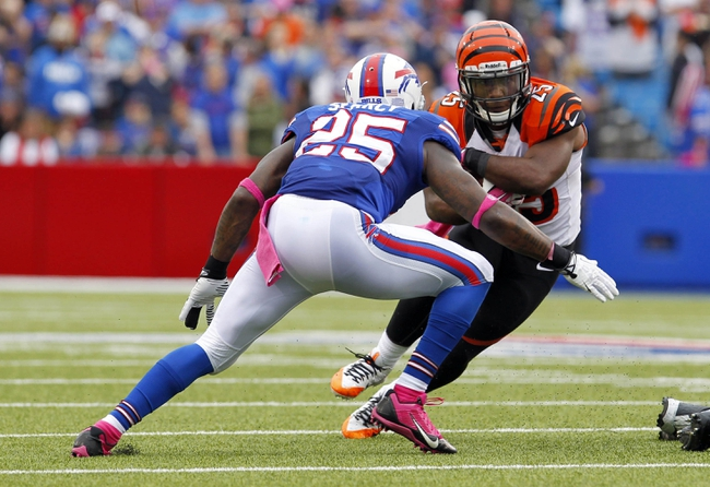 Oct 13, 2013; Orchard Park, NY, USA; Buffalo Bills strong safety Da'Norris Searcy (25) looks to try and make a tackle on Cincinnati Bengals running back Giovani Bernard (25) during the first half at Ralph Wilson Stadium. Bengals beat the Bills 27 to 24 in overtime.  Mandatory Credit: Timothy T. Ludwig-USA TODAY Sports