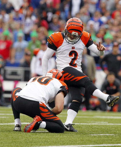 Oct 13, 2013; Orchard Park, NY, USA; Cincinnati Bengals kicker Mike Nugent (2) kicks the game winning field goal in overtime against the Buffalo Bills at Ralph Wilson Stadium. Bengals beat the Bills 27 to 24 in overtime.  Mandatory Credit: Timothy T. Ludwig-USA TODAY Sports