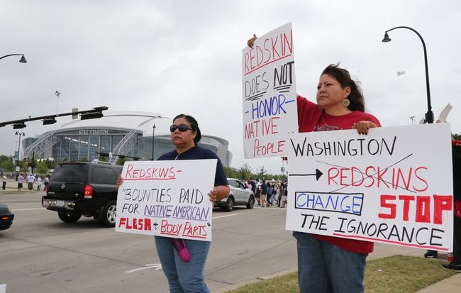 Oct 13, 2013; Arlington, TX, USA; Diana Parton (left) and Yolonda Bluehorse protest outside AT&T Stadium prior to the game with the Dallas Cowboys playing against the Washington Redskins at AT&T Stadium. Mandatory Credit: Matthew Emmons-USA TODAY Sports