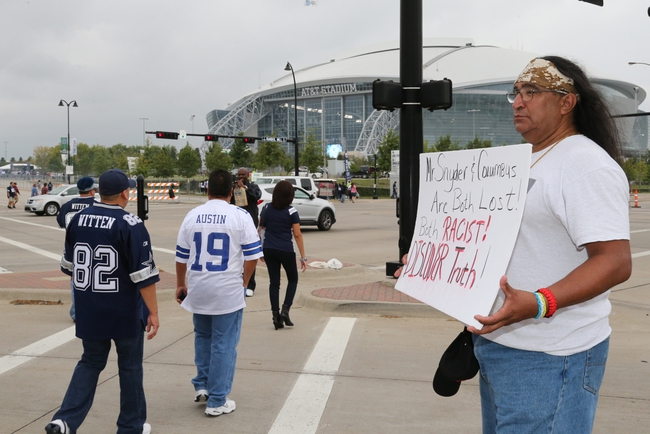 Oct 13, 2013; Arlington, TX, USA; Juan Mancias with the tribe Carrizo in the Nation of Texas protest outside AT&T Stadium prior to the game with the Dallas Cowboys playing against the Washington Redskins at AT&T Stadium. Mandatory Credit: Matthew Emmons-USA TODAY Sports