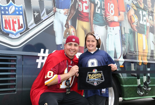 Oct 13, 2013; Arlington, TX, USA; Dallas Cowboys fan Ava Thomas (age 8) poses for a photo with Washington Redskins fan Michael Tovar at AT&T Stadium. Mandatory Credit: Matthew Emmons-USA TODAY Sports