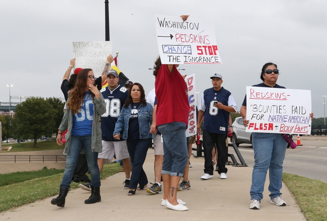 Oct 13, 2013; Arlington, TX, USA; Diana Parton (right) and Yolonda Bluehorse protest outside AT&T Stadium prior to the game with the Dallas Cowboys playing against the Washington Redskins at AT&T Stadium. Mandatory Credit: Matthew Emmons-USA TODAY Sports