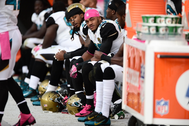 Oct 13, 2013; Denver, CO, USA; Jacksonville Jaguars free safety Josh Evans (26) on the bench late in the fourth quarter against the Denver Broncos at Sports Authority Field at Mile High. The Broncos defeated the Jaguars 35-19. Mandatory Credit: Ron Chenoy-USA TODAY Sports