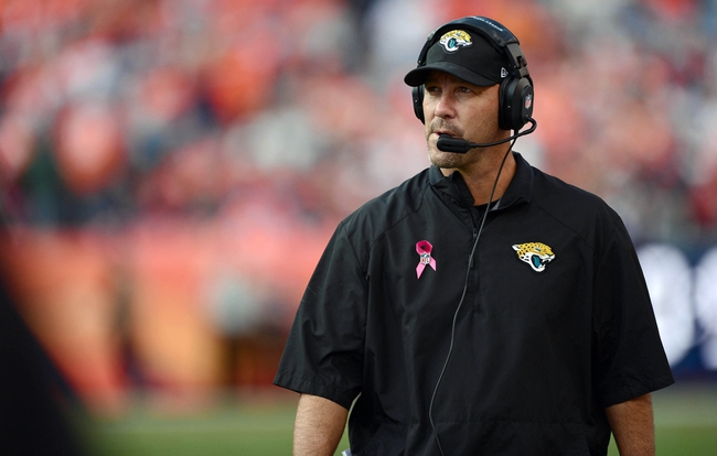 Oct 13, 2013; Denver, CO, USA; Jacksonville Jaguars head coach Gus Bradley walks his sidelines in the third quarter against the Denver Broncos at Sports Authority Field at Mile High. The Broncos defeated the Jaguars 35-19. Mandatory Credit: Ron Chenoy-USA TODAY Sports