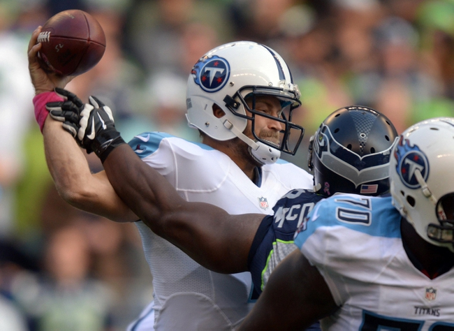 Oct 13, 2013; Seattle, WA, USA; Tennessee Titans quarterback Ryan Fitzpatrick (4) is pressured by Seattle Seahawks defensive tackle Clinton McDonald (69) at CenturyLink Field. The Seahawks defeated the Titans 20-13. Mandatory Credit: Kirby Lee-USA TODAY Sports