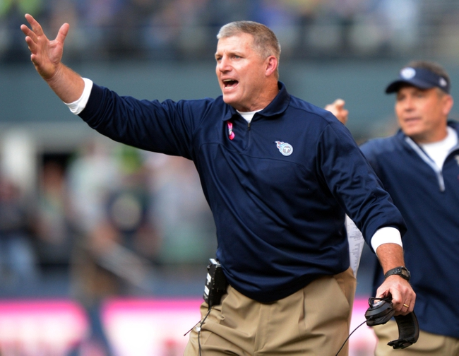 Oct 13, 2013; Seattle, WA, USA; Tennessee Titans coach Mike Munchak reacts during the game against the Seattle Seahawks at CenturyLink Field. Mandatory Credit: Kirby Lee-USA TODAY Sports