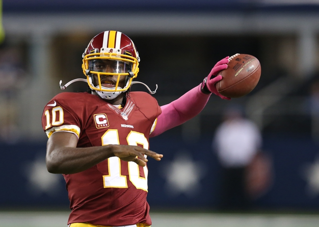 Oct 13, 2013; Arlington, TX, USA; Washington Redskins quarterback Robert Griffin III (10) throws left handed prior to the game against the Dallas Cowboys at AT&T Stadium. Mandatory Credit: Matthew Emmons-USA TODAY Sports