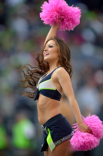 Oct 13, 2013; Seattle, WA, USA; Seattle Seahawks sea gals cheerleaders perform with pink pom poms to recognize breast cancer awareness month during the game against the Tennessee Titans at CenturyLink Field. Mandatory Credit: Kirby Lee-USA TODAY Sports