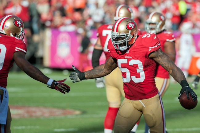 Oct 13, 2013; San Francisco, CA, USA; San Francisco 49ers inside linebacker NaVorro Bowman (53) celebrates with defensive back Perrish Cox (20) after recovering a fumble during the fourth quarter at Candlestick Park. The San Francisco 49ers defeated the Arizona Cardinals 32-20. Mandatory Credit: Ed Szczepanski-USA TODAY Sports