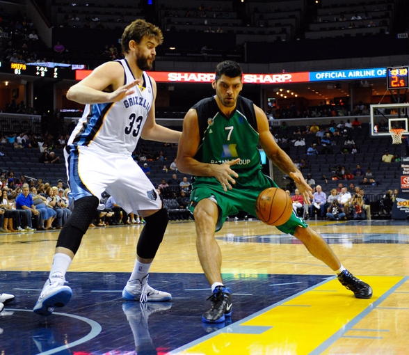 Oct 13, 2013; Memphis, TN, USA; Haifa center Alex Chubrevich (7) handles the ball against Memphis Grizzlies center Marc Gasol (33) during the second half at FedExForum. Memphis Grizzlies defeat Haifa 116-70. Mandatory Credit: Justin Ford-USA TODAY Sports