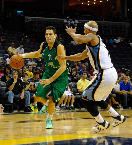 Oct 13, 2013; Memphis, TN, USA; Haifa forward Ben Reis (11) handles the ball against Memphis Grizzlies point guard Jerryd Bayless (7) during the second half at FedExForum. Memphis Grizzlies defeat Haifa 116-70. Mandatory Credit: Justin Ford-USA TODAY Sports