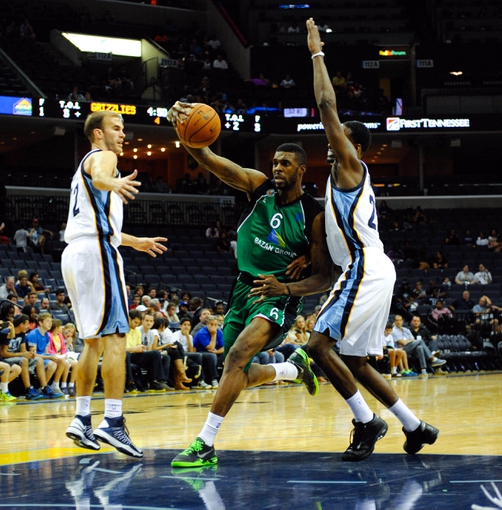 Oct 13, 2013; Memphis, TN, USA; Haifa forward Donta Smith  (6) handles the ball against Memphis Grizzlies shooting guard Jamaal Franklin (22) and Memphis Grizzlies shooting guard Nick Calathes (12) during the second half at FedExForum. Memphis Grizzlies defeat Haifa 116-70. Mandatory Credit: Justin Ford-USA TODAY Sports