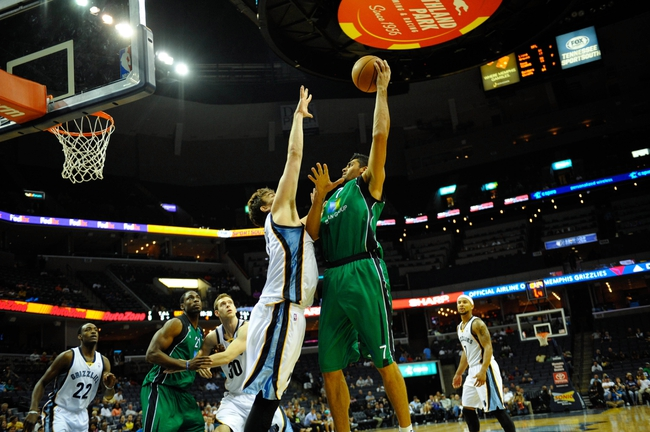 Oct 13, 2013; Memphis, TN, USA; Haifa center Alex Chubrevich (7) takes a shot against Memphis Grizzlies center Marc Gasol (33) during the second half at FedExForum. Memphis Grizzlies defeat Haifa 116-70. Mandatory Credit: Justin Ford-USA TODAY Sports