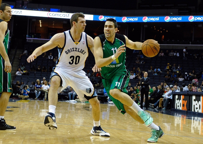 Oct 13, 2013; Memphis, TN, USA; Haifa forward Ben Reis (11) handles the ball against Memphis Grizzlies power forward Jon Leuer (30) during the second half at FedExForum. Memphis Grizzlies defeat Haifa 116-70. Mandatory Credit: Justin Ford-USA TODAY Sports