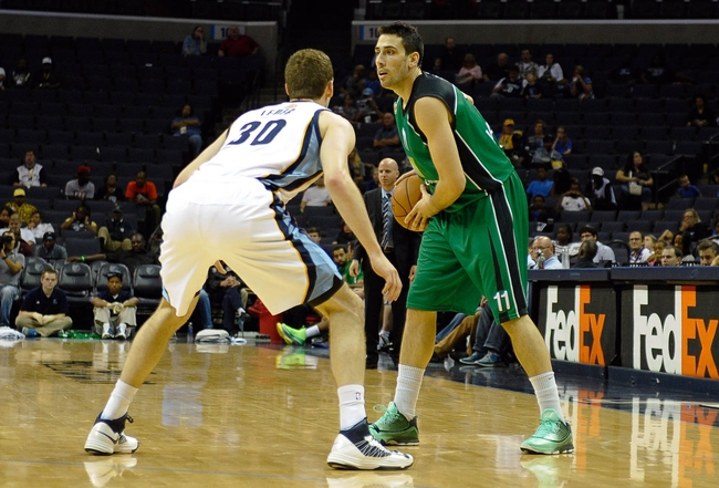 Oct 13, 2013; Memphis, TN, USA; Haifa forward Ben Reis (11) looks for a open man against Memphis Grizzlies power forward Jon Leuer (30) during the second half at FedExForum. Memphis Grizzlies defeat Haifa 116-70. Mandatory Credit: Justin Ford-USA TODAY Sports