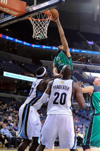 Oct 13, 2013; Memphis, TN, USA; Haifa forward Brian Randle (15) dunks the ball during the second half against the Memphis Grizzlies at FedExForum. Memphis Grizzlies defeat Haifa 116-70. Mandatory Credit: Justin Ford-USA TODAY Sports