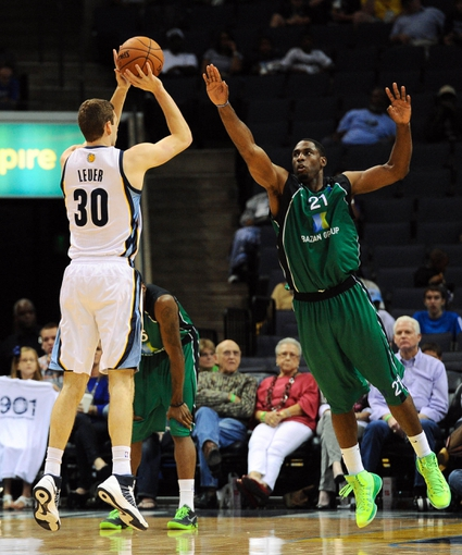 Oct 13, 2013; Memphis, TN, USA; Memphis Grizzlies power forward Jon Leuer (30) takes a shot against Haifa forward Ike Ofoegbu  (21) at FedExForum. Memphis Grizzlies defeat Haifa 116-70. Mandatory Credit: Justin Ford-USA TODAY Sports