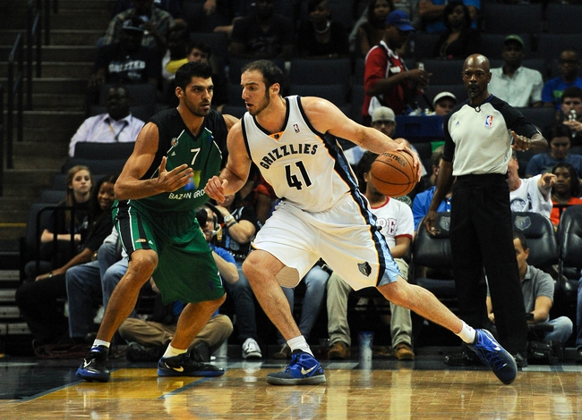 Oct 13, 2013; Memphis, TN, USA; Memphis Grizzlies center Kosta Koufos (41) posts up against Haifa center Alex Chubrevich (7) during the second half at FedExForum. Memphis Grizzlies defeat Haifa 116-70. Mandatory Credit: Justin Ford-USA TODAY Sports