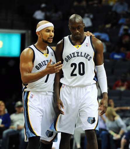 Oct 13, 2013; Memphis, TN, USA; Memphis Grizzlies point guard Jerryd Bayless (7) and Memphis Grizzlies small forward Quincy Pondexter (20) talk during a timeout in the second half against Haifa at FedExForum. Memphis Grizzlies defeat Haifa 116-70. Mandatory Credit: Justin Ford-USA TODAY Sports