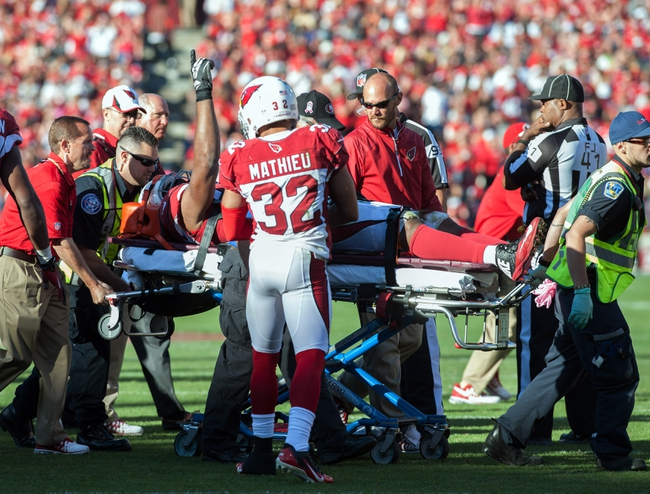 Oct 13, 2013; San Francisco, CA, USA; Arizona Cardinals defensive end Calais Campbell (93) signals to the crowd as he is carted off the field after an injury during the fourth quarter of the game against the San Francisco 49ers at Candlestick Park. The San Francisco 49ers defeated the Arizona Cardinals 32-20. Mandatory Credit: Ed Szczepanski-USA TODAY Sports
